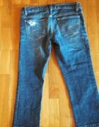 Sprzedam jeansy z dziurą na kolanieRozmiar 34...