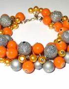 pomarańczowo srebrna gęsta bransoletka
