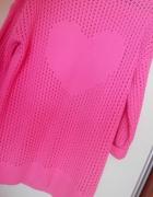 Rozowy azurowy sweter oversize