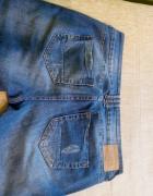 Jeansy z przetarciami rozmiar 40