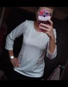 Biała elegancka bluzka...