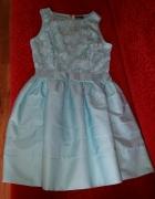 Urocza rozkloszowana sukienka idealna na wesele