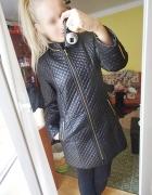 Elegancki pikowany płaszcz princess