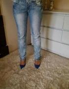 Cieniowane jeansy