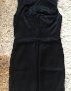 Elegancka sukienka czarna z lekkim połyskiem...