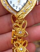 pozlacany zegarek serduszko na bransoletce cyrkoni