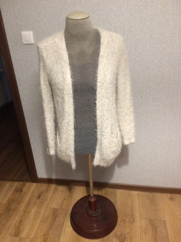 włchaty sweter