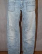 Jeansy spodnie z dziurami jasny jeans Diesel W27...
