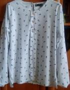 Biała koszula w osiołki