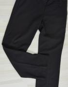 Czarne eleganckie spodnie w prążki Orsay...