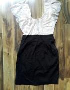 Ołówkowa sukienka z motylkowymi rękawami 36...