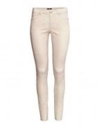 białe H&M spodnie rurki strukturalny wzór superstrech elastyczne tregginsy stretch