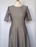 Rozkloszowana sukienka w kratkę Warehouse