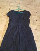 Sprzedam czarną sukienkę tunikę z dość głębokim dekoltem...