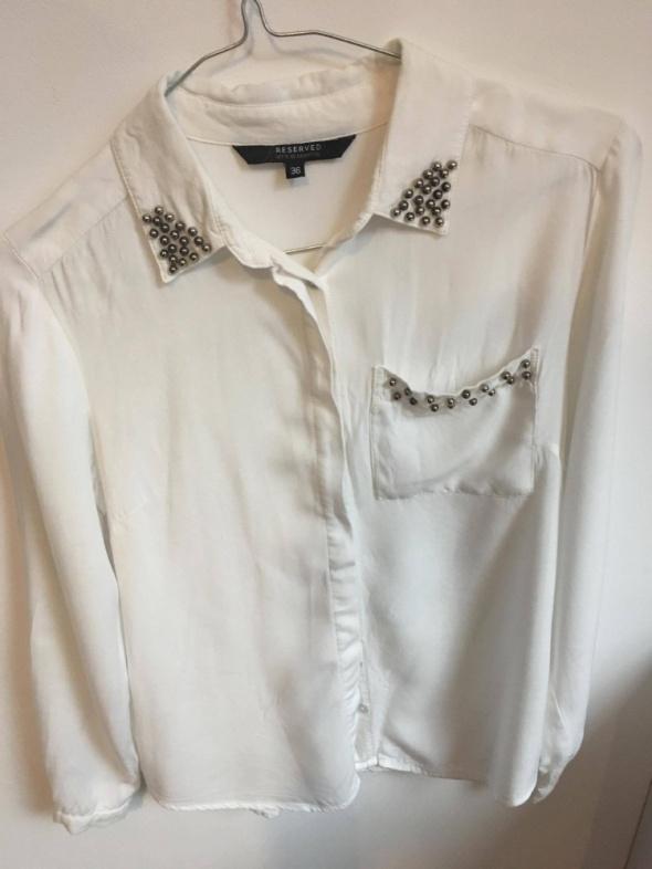 Biała elegancka bluzka Reserved...