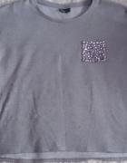Szara bluza elegancka z kieszonką z cekinami L 42...