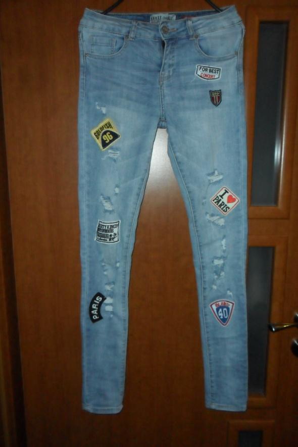 Nowe spodnie z naszywkami dziury przetarcia Rozm 34 House