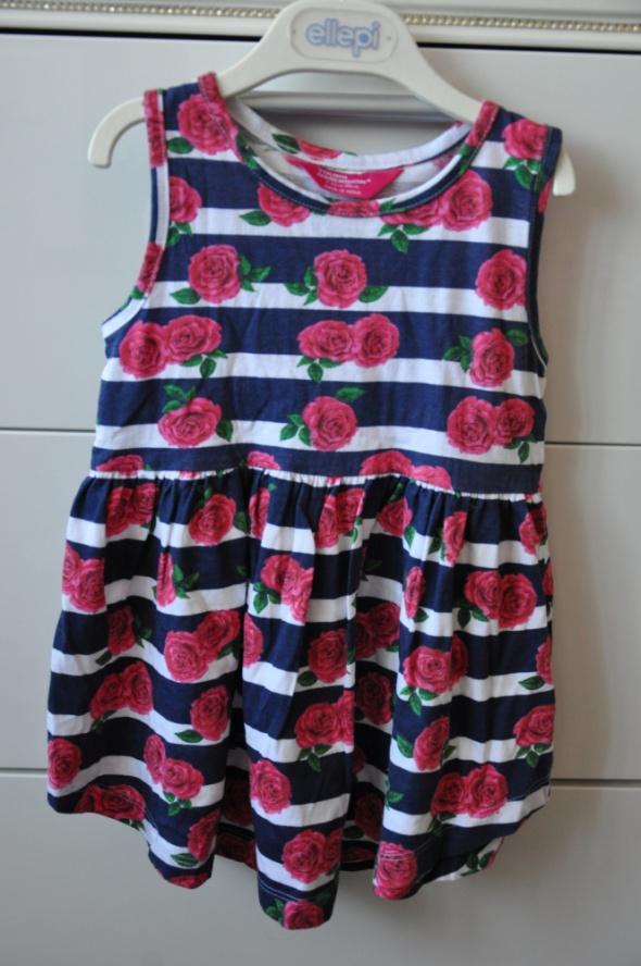 Śliczna sukienka w paski z różami...