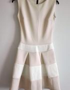 rozkloszowana sukienka nude 34