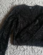 Futrzasty sweter...