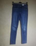 Ciemno niebieskie elastyczne jeansy rurki skinn