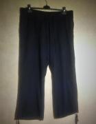 Granatowe materiałowe spodnie ze ściągaczami 50...