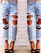 Spodnie jeansowe dziury mega