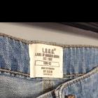 Spódniczka jeansowa mini 42 XL przetarcia