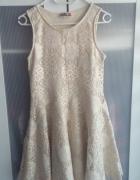 Koronkowa beżowa sukienka