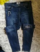 spodnie rurki new look dziura na kolanie 42