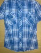 Niebieska koszula w kratke...