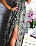 dluga sukienka czarno biala wyciecie zip