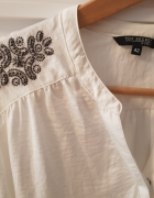 Elegancka damska koszula...