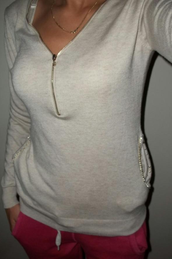 Beżowy sweterek melanż koronka zip