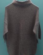 Szary sweter...