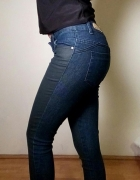 Obcisłe spodnie damskie dwukolorowe Sinsay