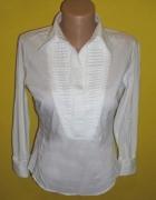 elegancka biała koszula marszczona przy dekoldzie