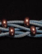 Pleciona bransoletka sznurek z metalowymi kółeczkami koloru srebrnego