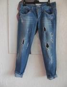 włoskie jeansy z dziurami...