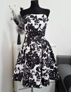 rozkloszowana biało czarna sukienka Atmosphere