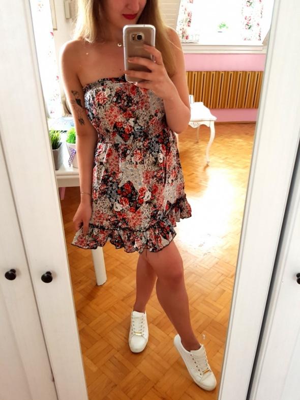 Kolorowa sukienka w kwiaty falbanka L 40