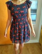 Granatowa sukienka w kokardki i kropki 3638