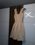 Sukienki koktajlowe Christiana Diora...