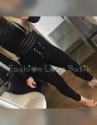 Czarne wiązane spodnie rurki