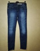 Granatowe elastyczne jeansy rurki skinny 36