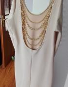Beżowa sukienka z odkrytymi plecami