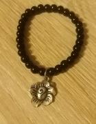 Piękna czarna bransoletka z zawieszką w kształcie róży