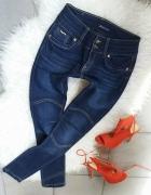jeansy rurki spodnie granatowe przeszycia na kolanach XS S