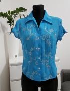 niebieska bluzka z haftem Nowum
