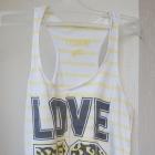 Bluzka na ramiączkach bokserka w biało żółte paski z nadrukiem poszerzona u dołu XS New Yorker